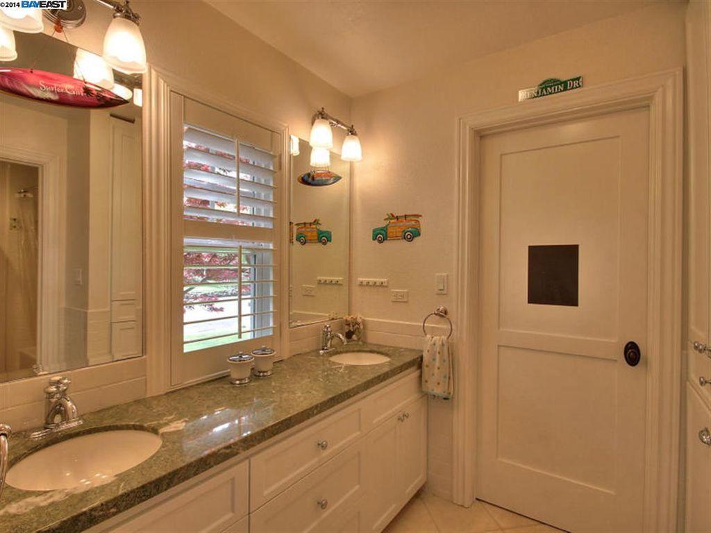 Contemporary Kids Bathroom with Complex granite counters & limestone ...