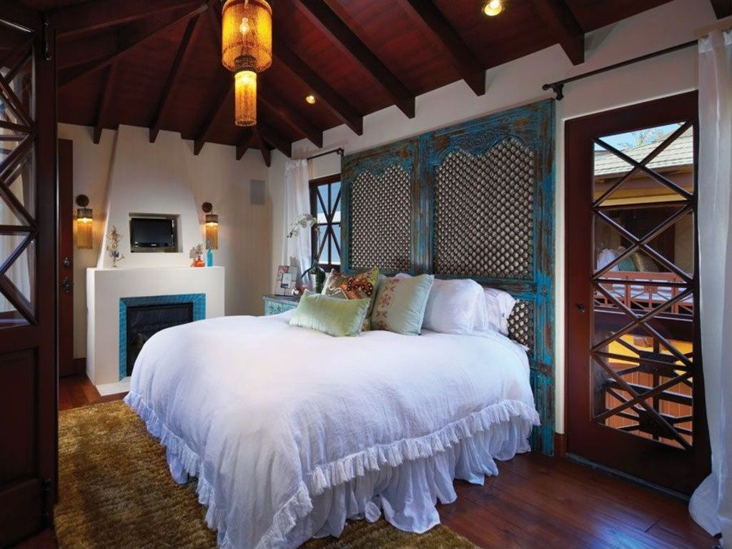 eclectic master bedroom with flush light u0026 cement fireplace