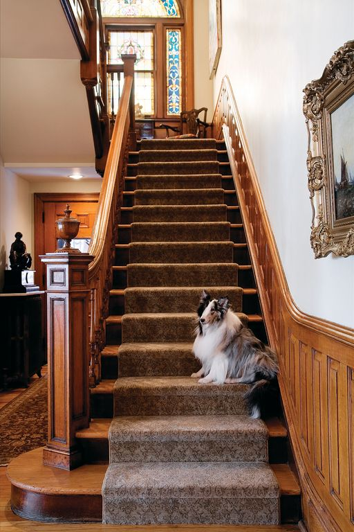 craftsman staircase with natural wood framing stained glass window hardwood floors wainscoting