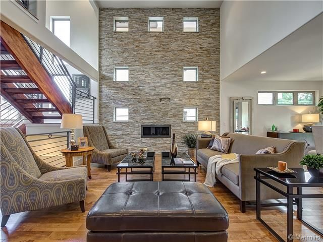 Living Room with stone fireplace by Rebecca Caiani | Zillow Digs ...