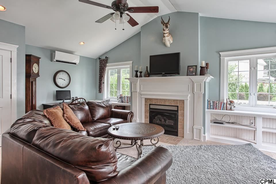 Traditional Living Room with stone fireplace & Built-in bookshelf ...