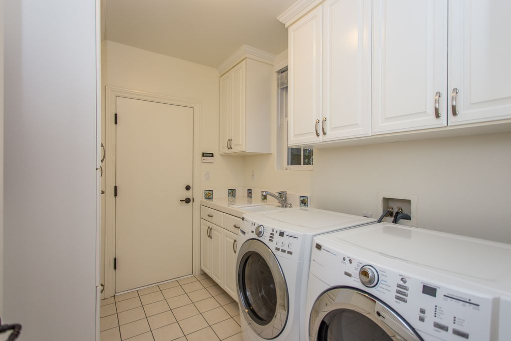 Transitional Laundry Room With Signature Hardware Low Profile Cabinet Pull Limestone Tile Floors Undermount