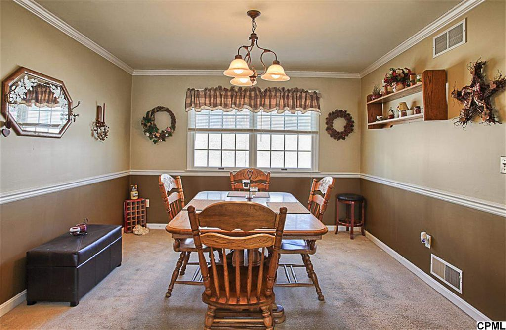 Country Dining Room With Carpet Chandelier Crown Molding Chair Rail