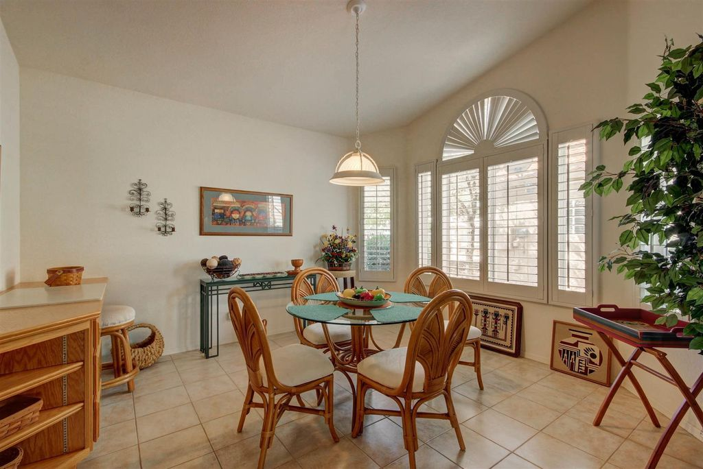 dining room with limestone tile floorsbill bisset | zillow