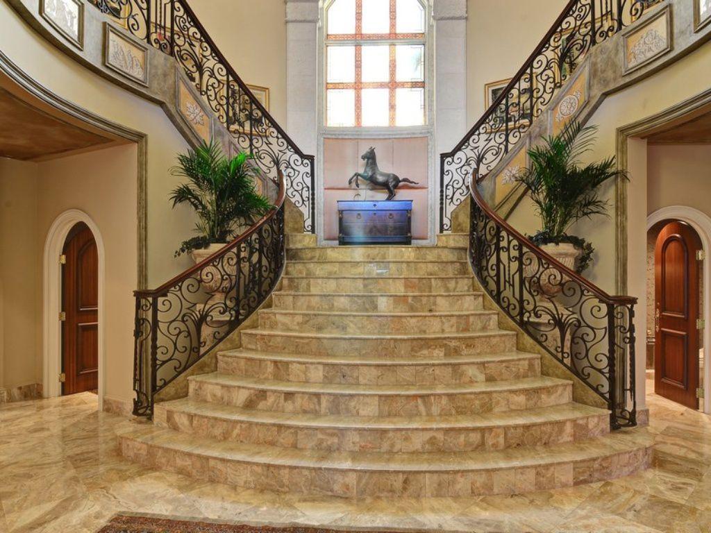 Mediterranean staircase with travertine tile floors wainscoting mediterranean staircase with high ceiling wainscoting travertine tile floors arched window dailygadgetfo Choice Image