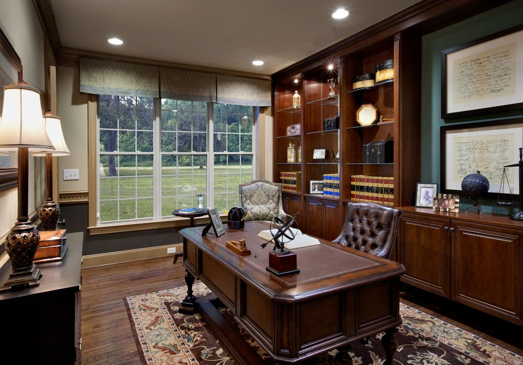 traditional home office with built in bookshelf caesar chocolate area rug executive swivel