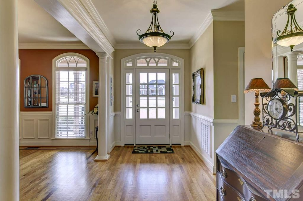 traditional entryway with high ceiling