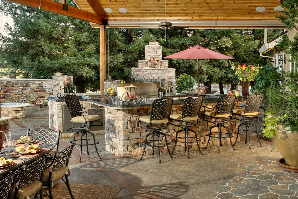 Country Patio With Outdoor Kitchen, Exterior Stone Floors, Fire Pit, Fence