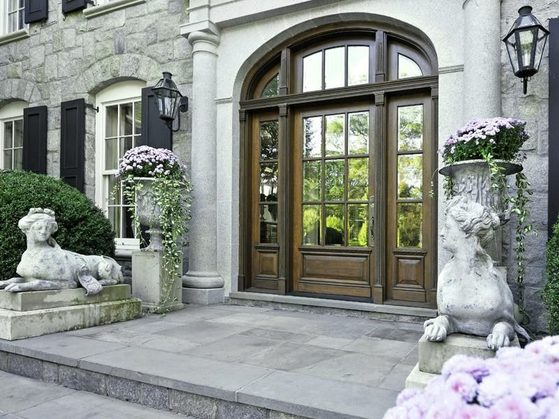 Traditional front door with arched transom window for European exterior doors