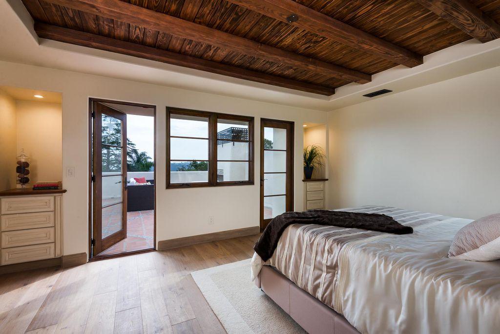 Mediterranean Guest Bedroom With Built In Bookshelf