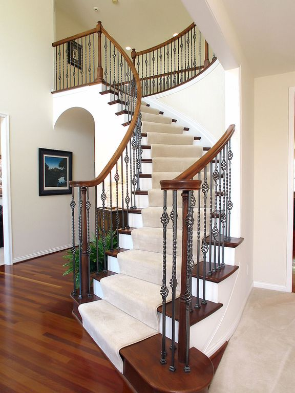 Traditional Staircase With Metal Staircase, Hardwood Floors, Double Basket  Baluster, High Ceiling,