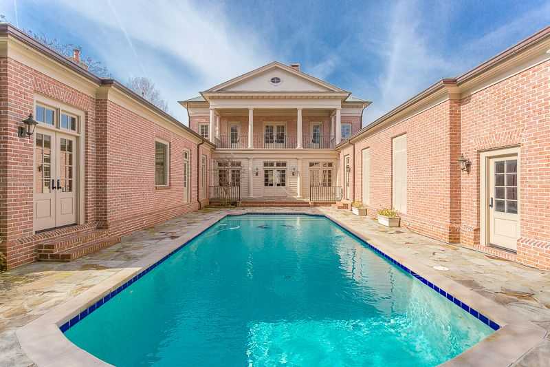 traditional swimming pool with lap pool & exterior stone floors in
