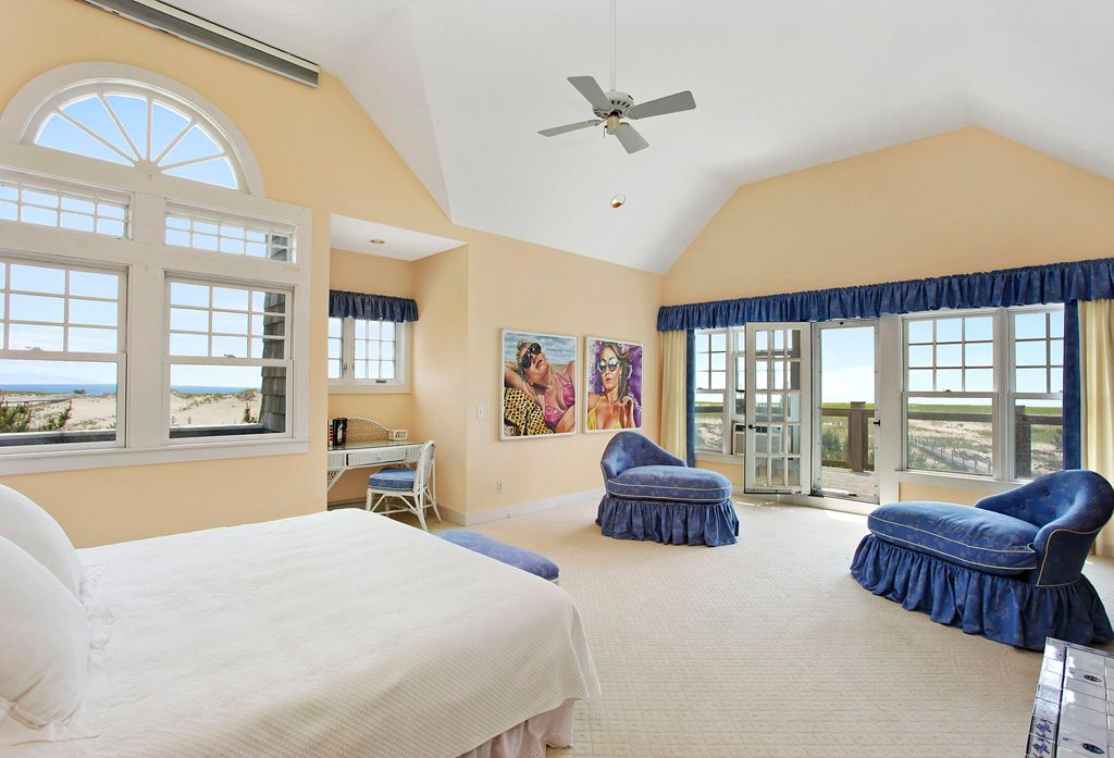 cottage master bedroom with transom windowthe corcoran group