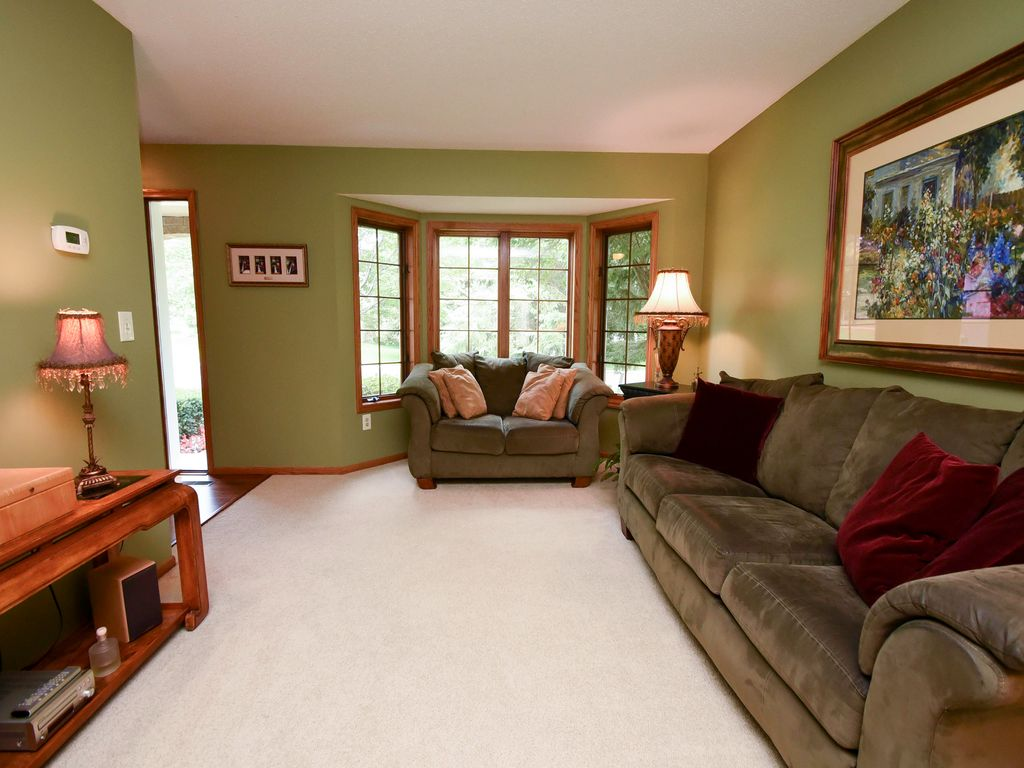 craftsman living room with carpet & hardwood floors in woodbury