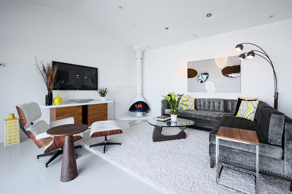 Modern Living Room With Hollywood Sectional In Brussels Charcoal Noguchi Table Eames Lounge Chair