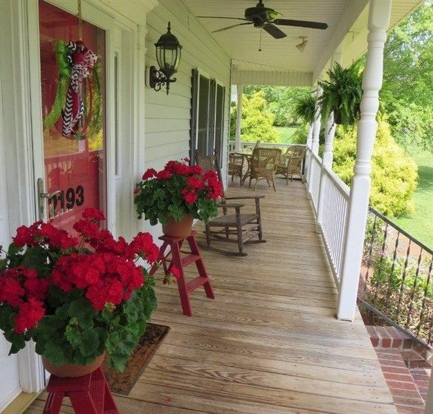 Porch Light Realtor: Cottage Porch With Exterior Brick Floors & Wrap Around