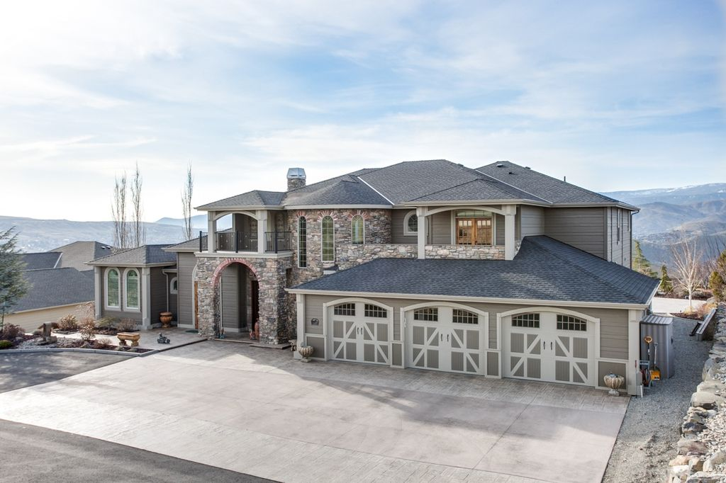 Contemporary Exterior Of Home With Pathway, Exterior Tile Floors, Barn Door,  Arched Window