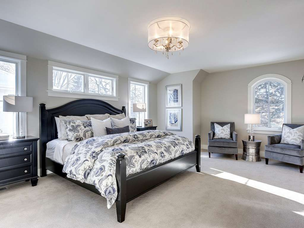 Traditional Master Bedroom with Hardwood floors & Carpet in ...