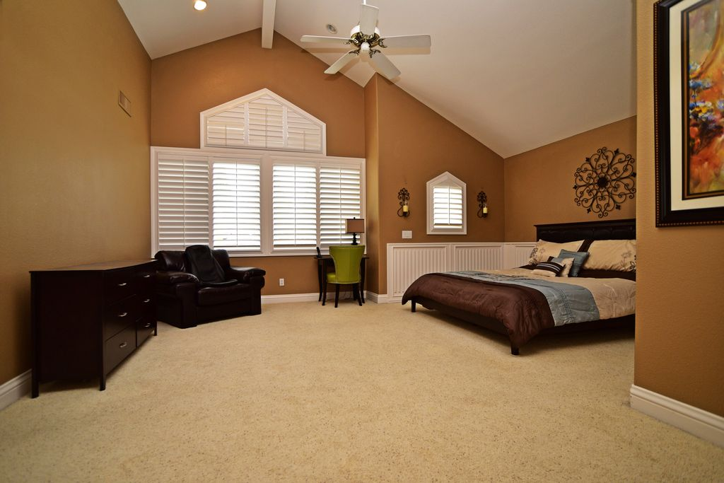 Contemporary Master Bedroom With Carpet, Exposed Beam, Wainscoting,  Cathedral Ceiling, Wall Sconce