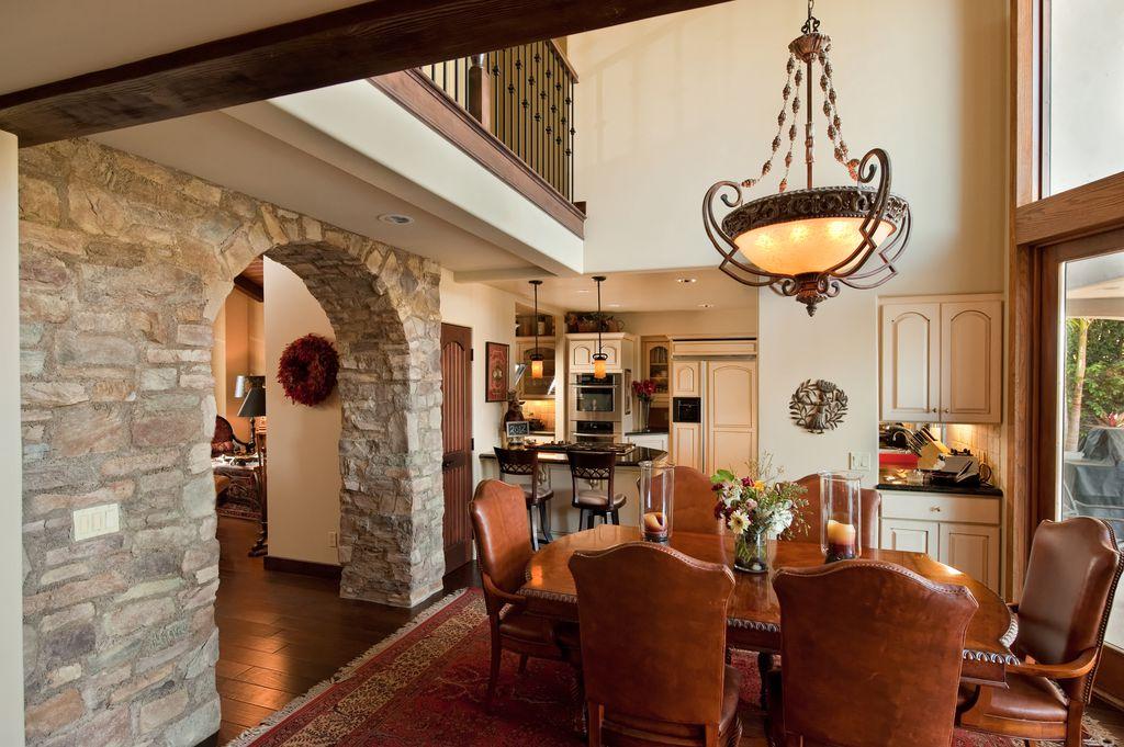 Mediterranean Dining Room With Laminate Floors Built In Bookshelf Loft Columns