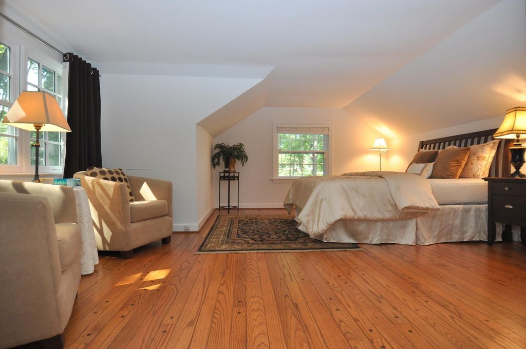 Traditional Master Bedroom with Hardwood floors & Oriental rug in ...