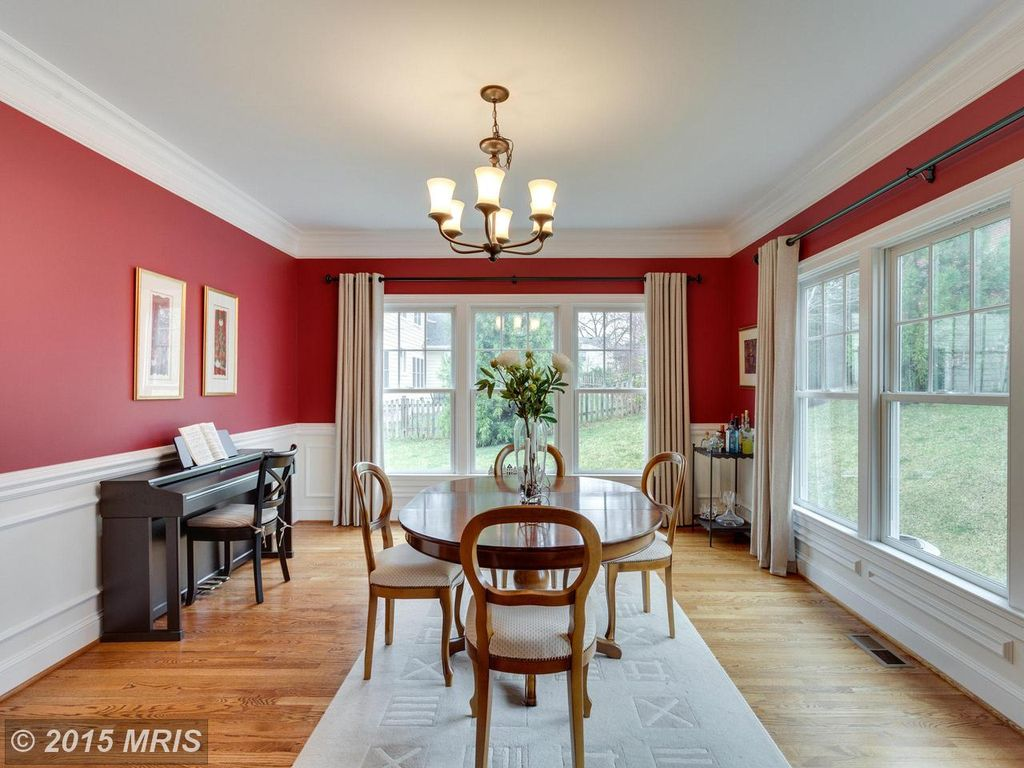 Traditional Dining Room With Carpet Wainscoting Hardwood Floors Chandelier Crown Molding