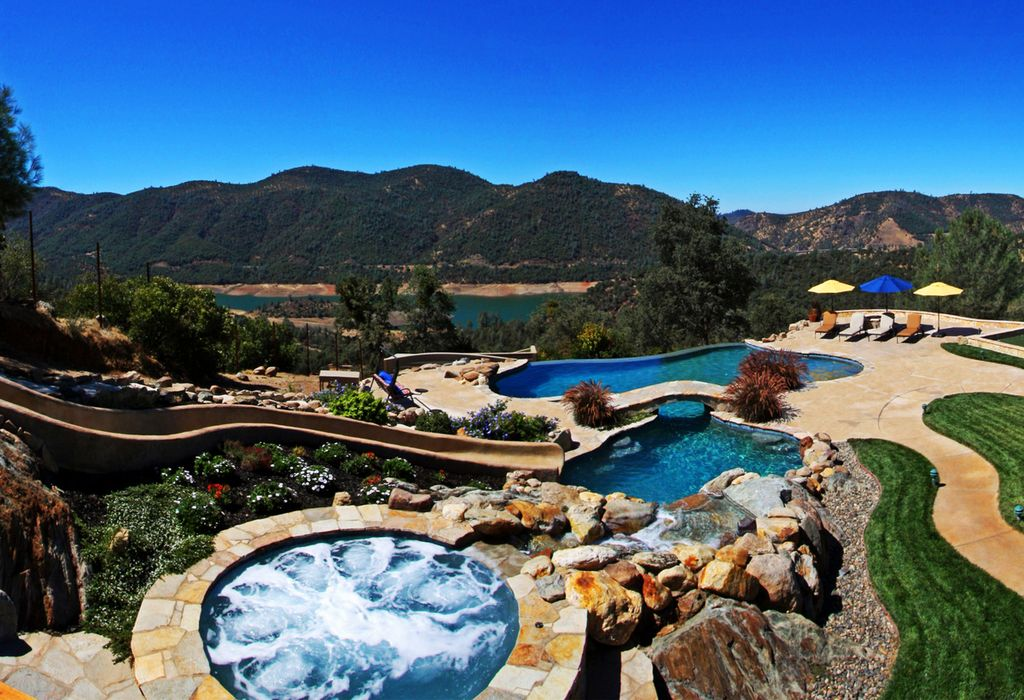 rustic swimming pool with waterfall pool with hot tub water slide pool