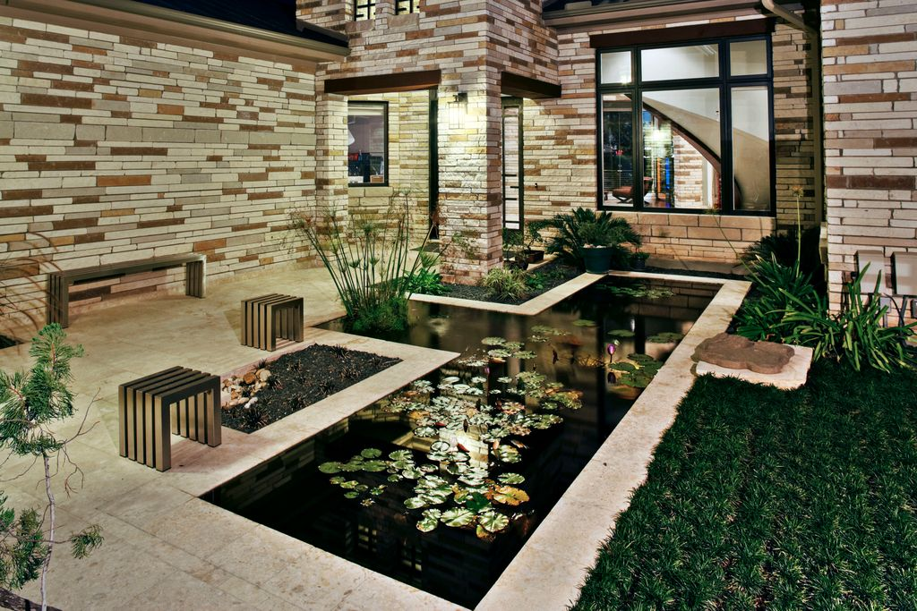 Contemporary Landscape/Yard With Exterior Stone Siding, Exterior Accent  Lighting, Koi Pond,