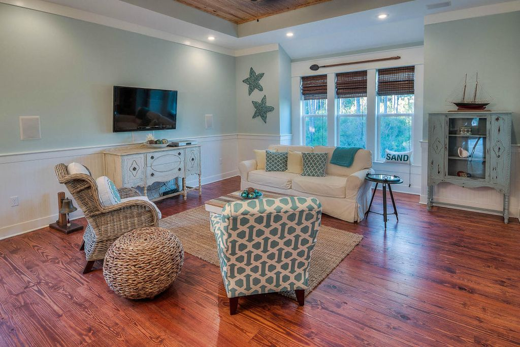 Cottage Living Room With Window Seat Carpet Wainscoting High Ceiling Fan