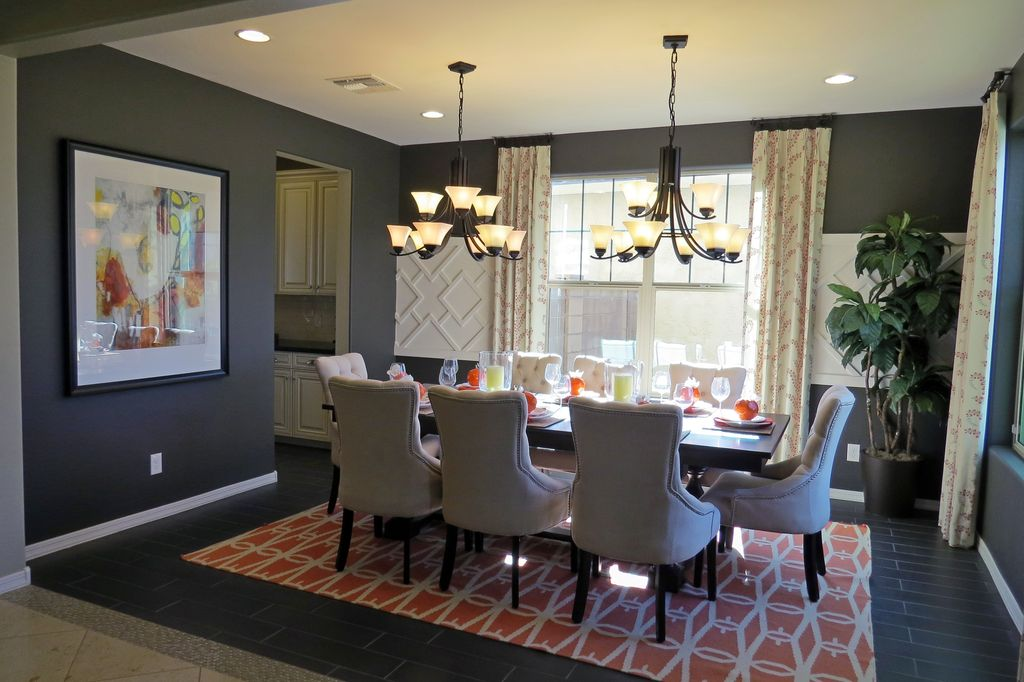 Traditional Dining Room With Carpet, High Ceiling, Travertine Tile Floors,  Chandelier