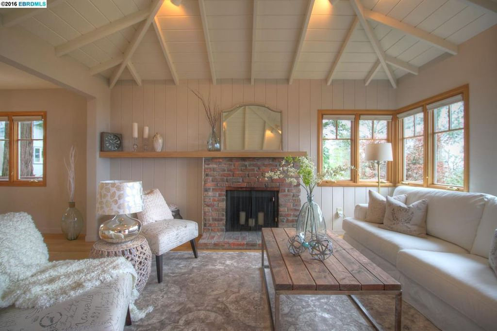 cottage living room with carpet  u0026 cathedral ceiling in
