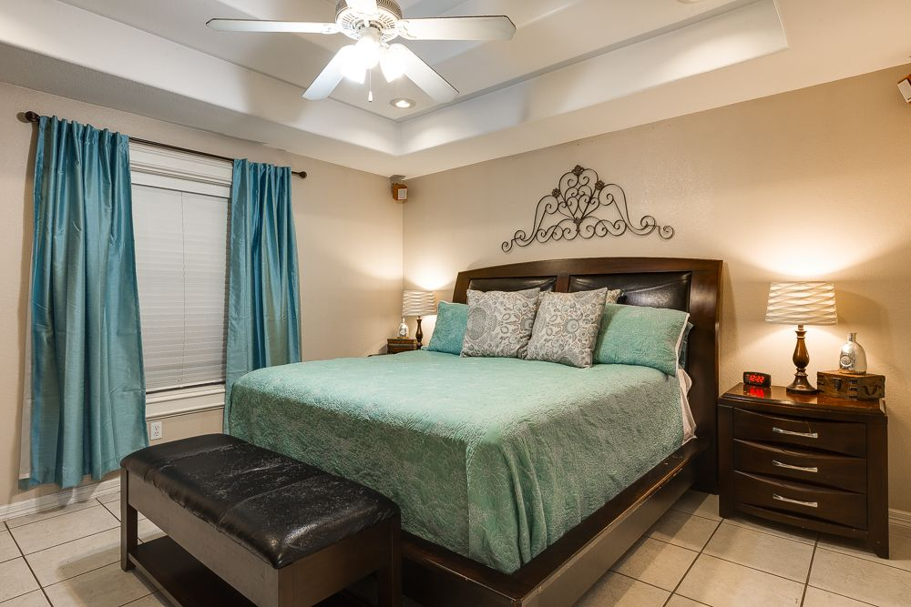 Traditional Master Bedroom with limestone tile floors & Ceiling ...
