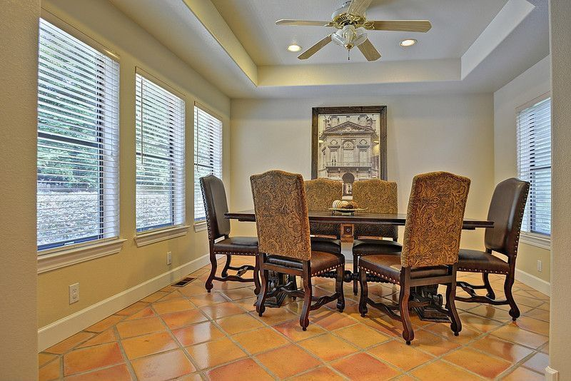 Traditional Dining Room With Ceiling Fan, Terracotta Tile Floors