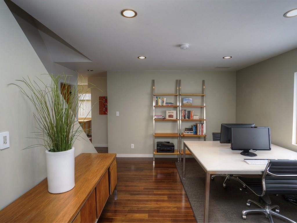 Modern Home Office With High Ceiling, Carpet, Hardwood Floors