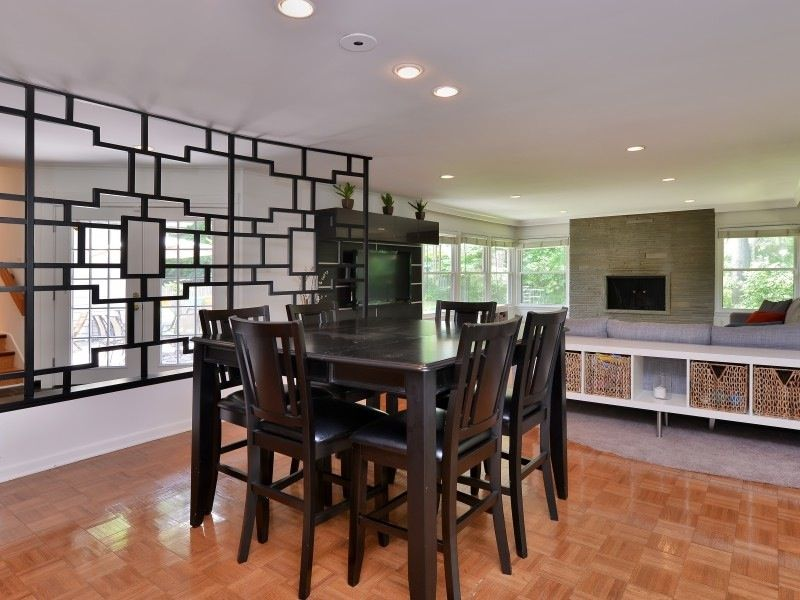 Contemporary Dining Room With Hardwood Floors, Wood Parquet Floor, Open  Geometric Room Divider