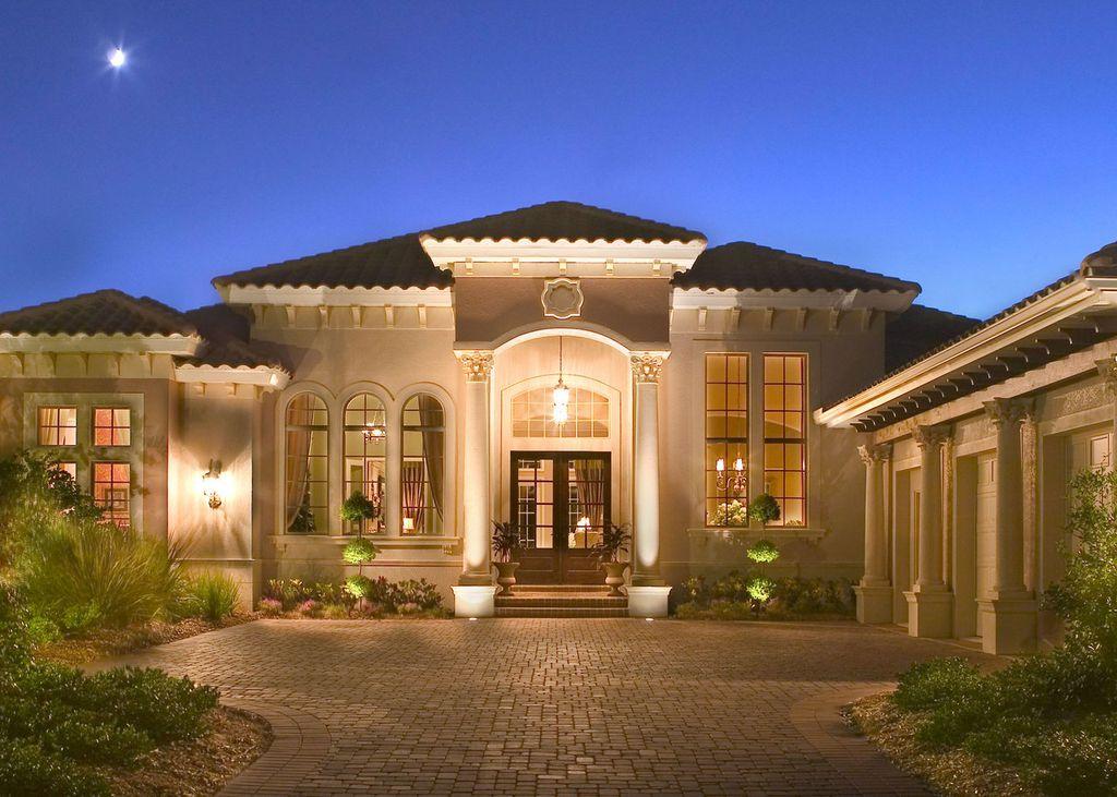 Mediterranean Exterior Of Home With Exterior Brick Floors, Topiary, Roman  Corinthian Order PolyStone Composite