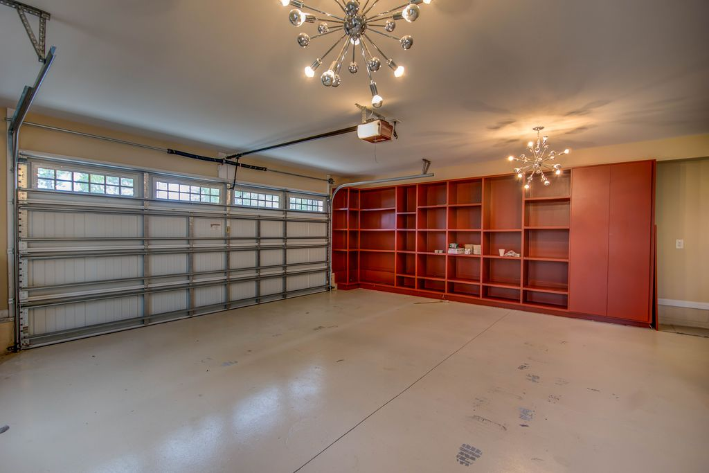 18x20 Garage With High Cielings : Modern garage with chandelier concrete floors in