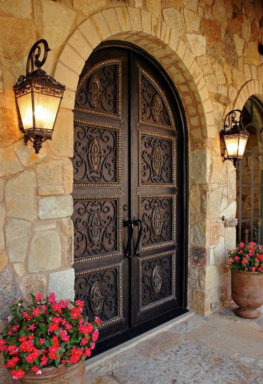 Mediterranean front door with exterior stone floors for Mediterranean style front doors