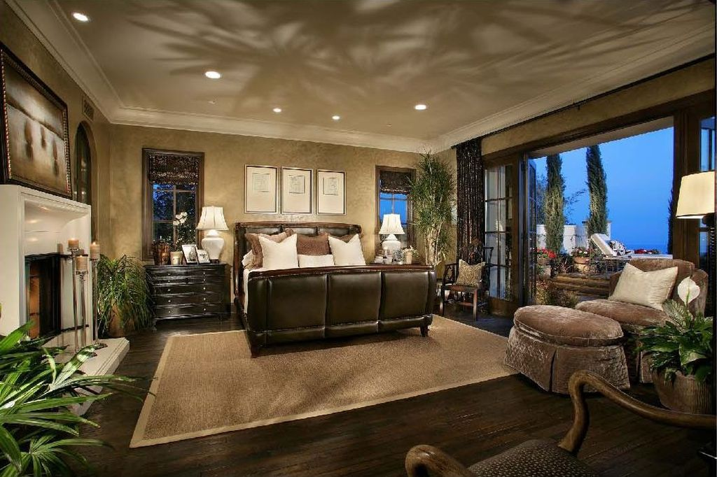 Mediterranean Master Bedroom With High Ceiling amp Crown