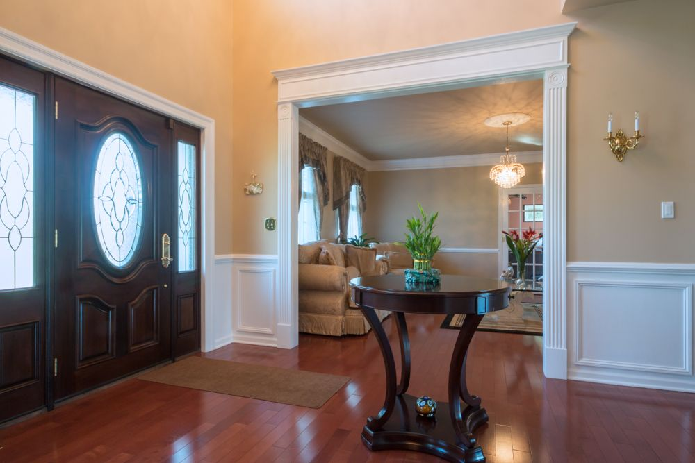 Chair Rail Entryway Part - 31: Traditional Entryway With High Ceiling, Hardwood Floors, Chair Rail, Glass  Panel Door,