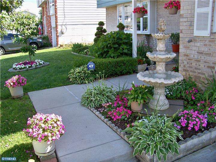 Traditional Landscape/Yard With Classic Tulip 3 Tiered Outdoor Water  Fountain, Exterior Stone Floors