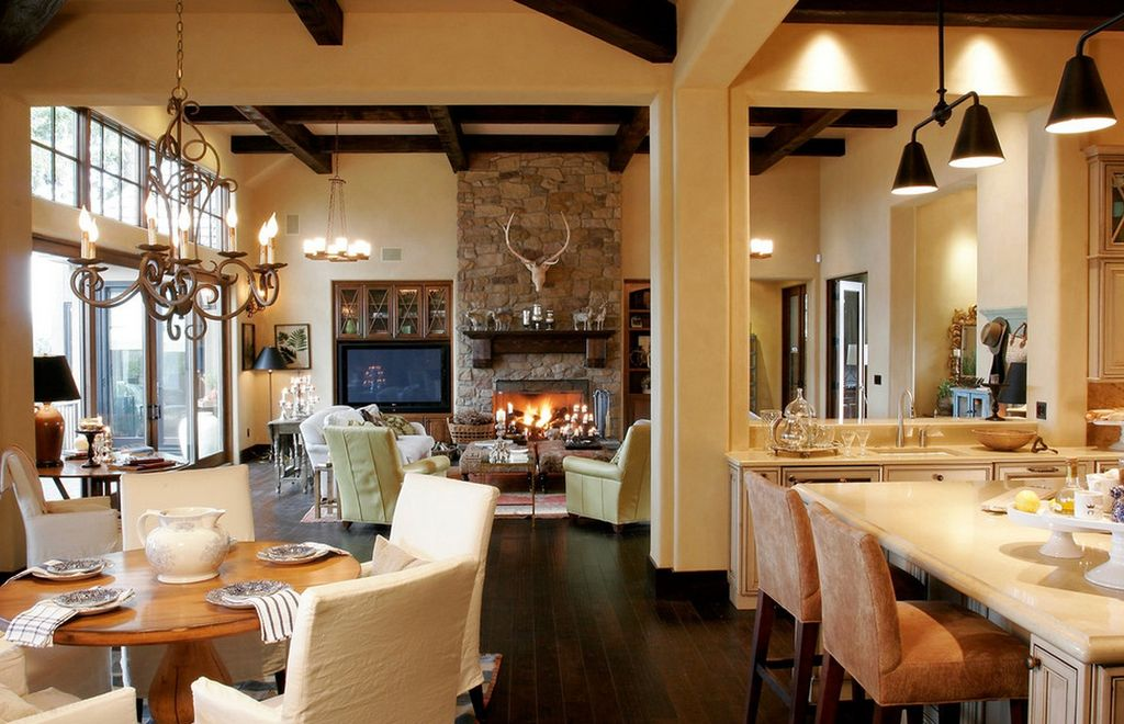 Rustic Great Room With Hardwood Floors, Columns, Stone Fireplace,  Chandelier, Pendant Light