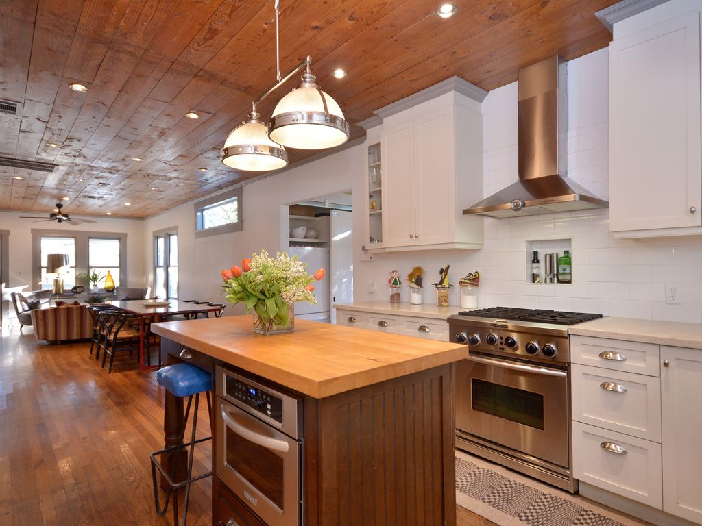 Country Kitchen with Hardwood floors, Crown molding, Clemson Classic Double  Pendant, Flat panel
