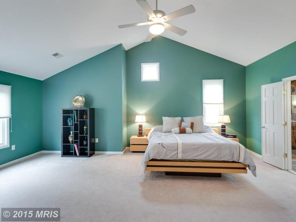 Superior Modern Master Bedroom With Flush Light, Ceiling Fan, Carpet, High Ceiling