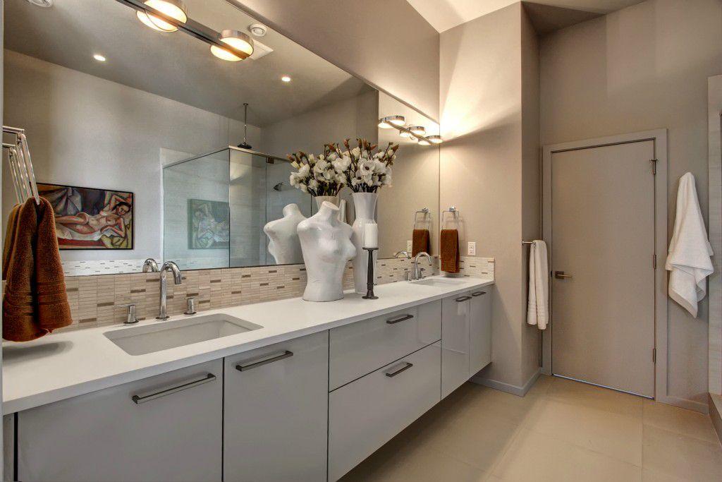 master bathroom with super white quartz sandstone tile floors wall sconce city