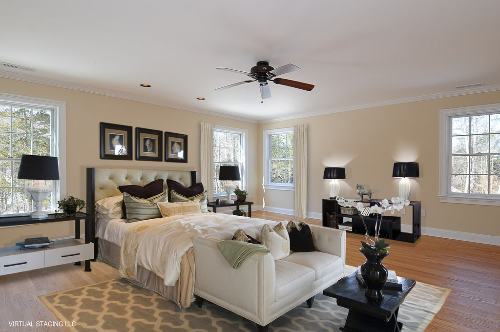 Art Deco Master Bedroom With Crown Molding, Carpet, Ceiling Fan, Hardwood  Floors