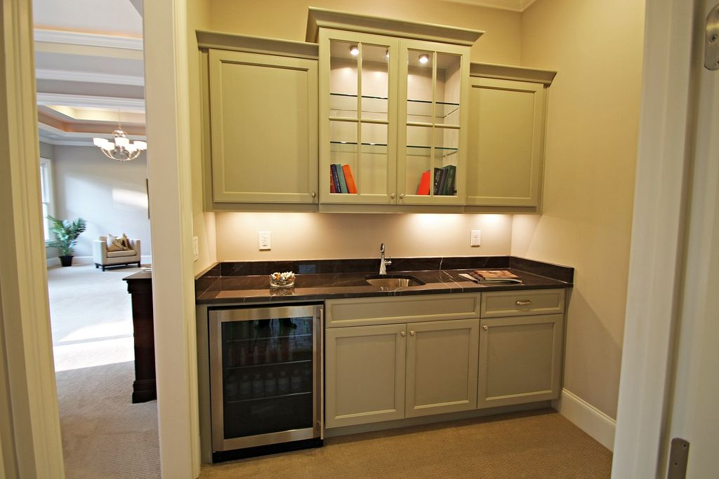 Traditional Bar With Glass Panel, Flush, Built In Bookshelf, Soapstone  Counters,