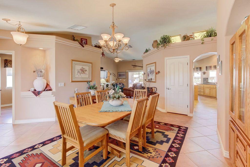Southwestern Dining Room With Limestone Tile Floors Specialty Door Chandelier Pendant Light