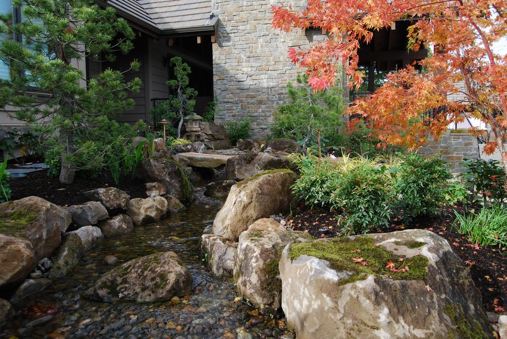 stone asian asian landscape and yard with pond by all oregon landscaping