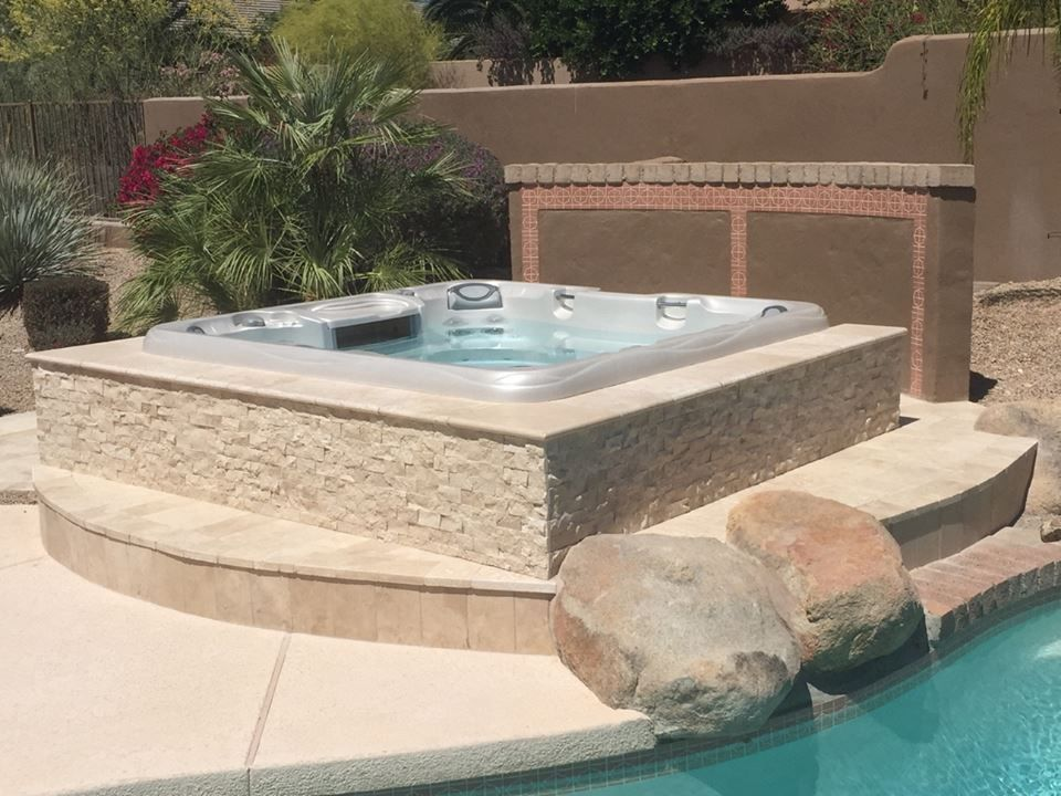 modern hot tub with fence exterior tile floors